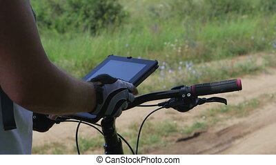 Cyclist using digital tablet for GPS navigation