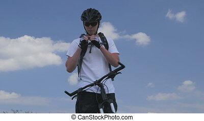 Teen boy on bike drinking water