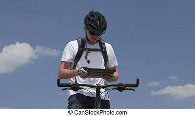 Mountain biker using digital tablet for GPS navigation