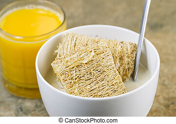 Horizontal photo of natural wheat cereal covered with honey...