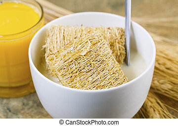 Whole grain Cereal along with orange juice ready for...