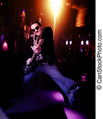 Rock 'n' Roll - Male lead guitarist with electric guitar...