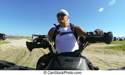 Man driving quadbike on the beach