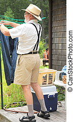 Wash day. - Country gentleman hanging clothes outside to...