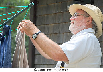 Wash day - Country gentleman hanging clothes to line dry...