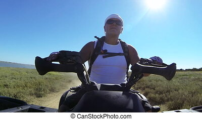 Summer tour on a quad atv - Man riding quad bike on a dusty...