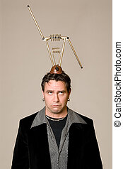 Bad Reception - Man with retro antenna on his head looking...