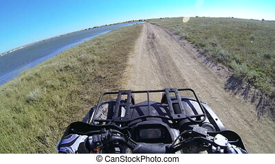 Riding quad bike POV - Riding quad bike on the dusty trail...