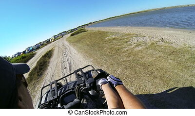 Ride quad bike on the sandy beach - Woman riding quad bike...