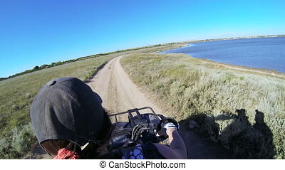 Female rider driving quad bike POV, GoPro Hero3 BE