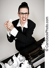 Writers Block - Retro business woman with vintage typewriter...