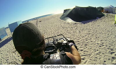 Woman riding quad bike on the beach - Woman riding quad bike...