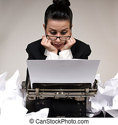 Writers Block - Retro business woman with vintage typewriter