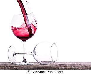 pair of full and empty wine glasses on a wooden table...