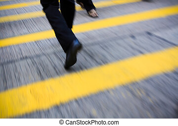 hurried pace on the crosswalk ,concept of urban pressure