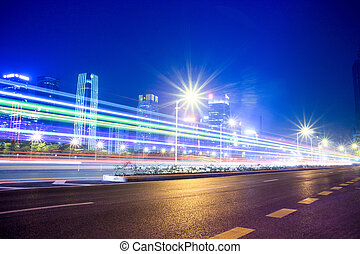 urban landscape at night and through the city traffic -...