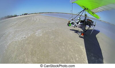 Motorized hang glider landing