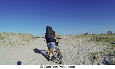 Woman traveling with bicycle - Woman traveling with a...