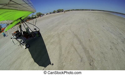 Motorized hang glider takeoff