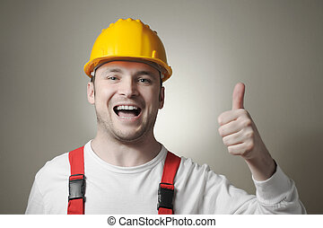 Happy young worker - Smiling young repairman with yellow...