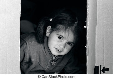 Girl moving to a new home - Portrait of a girl in a...