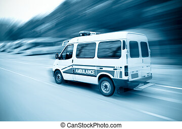 speeding ambulance - an ambulance driving fast on the...