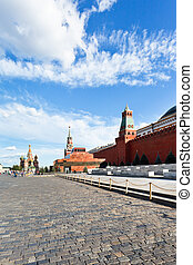 view of lenin mausoleum and kremlin wall on red square in...