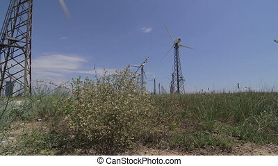 Dolly: Wind Turbine Farm - Wind turbine farm, tracking shot