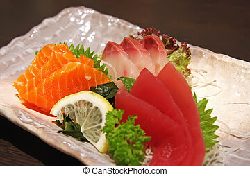 Sashimi arrangement - Arrangement of sashimi sliced raw...