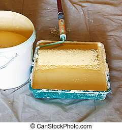 painter roller brush and bucket with paint - painter roller...