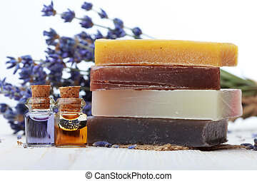 Handmade soap with lavender and essential oil on wooden...