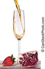 Splashing wine with pomegranate and strawberry fruit on a...