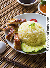 singapore chicken rice , traditional singaporean food with items as background