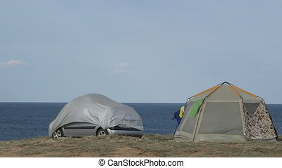 Camping site on cliff by sea
