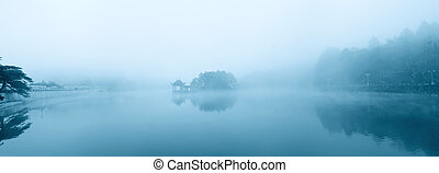 lake in the misty rain