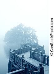 zigzag bridge and fog - fog and zigzag bridge in the lake