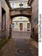 Backstreet - Empty desolated backstreet and arch in Vilnius...