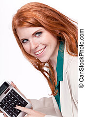 attractive smiling redhead business woman with calculator...