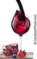 Splashing wine with pomegranate, blueberrie, strawberry...