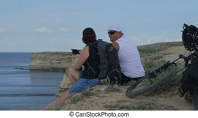 Couple traveling on mountain bike - Couple traveling on a...