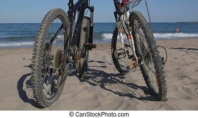 bikes on the summer beach - Two mountain bikes on the summer...