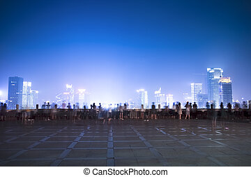 night scenes of city and people in the viewing platform