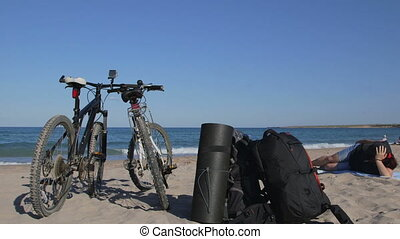 Mountain biking on summer beach - Mountain bikes on the...