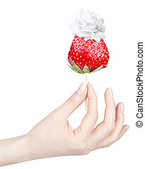 Whipped cream with tasty strawberry and hand - Whipped cream...