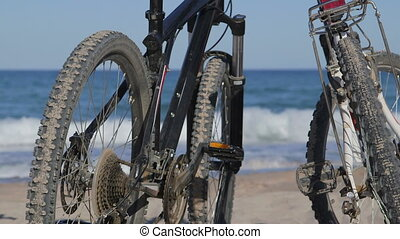 Two bikes on the summer beach - Two mountain bikes on the...
