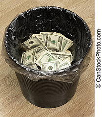 Bucket, dollars, two - A money is in a trash bucket