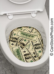 Toilet, dollars, one - A lot of money is flushed down the...