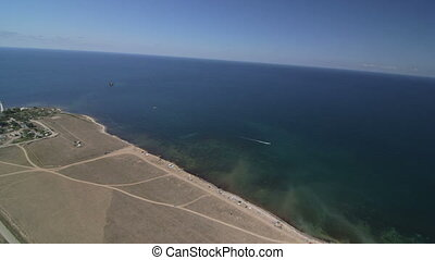 Flying above the coast of the sea - Aerial view of seashore...