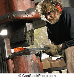 Man using power hammer. - Caucasian man using power hammer.