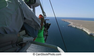 Aerial: Hang gliding - Flying over Black sea coast on...
